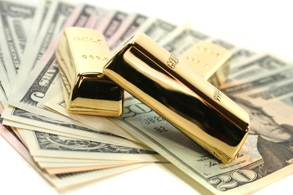 تأثير الذهب على العملات النقدية